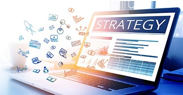 05.23.2018-strategy-text-with-business-icon-on-modern-laptop-screen-picture-id664356484