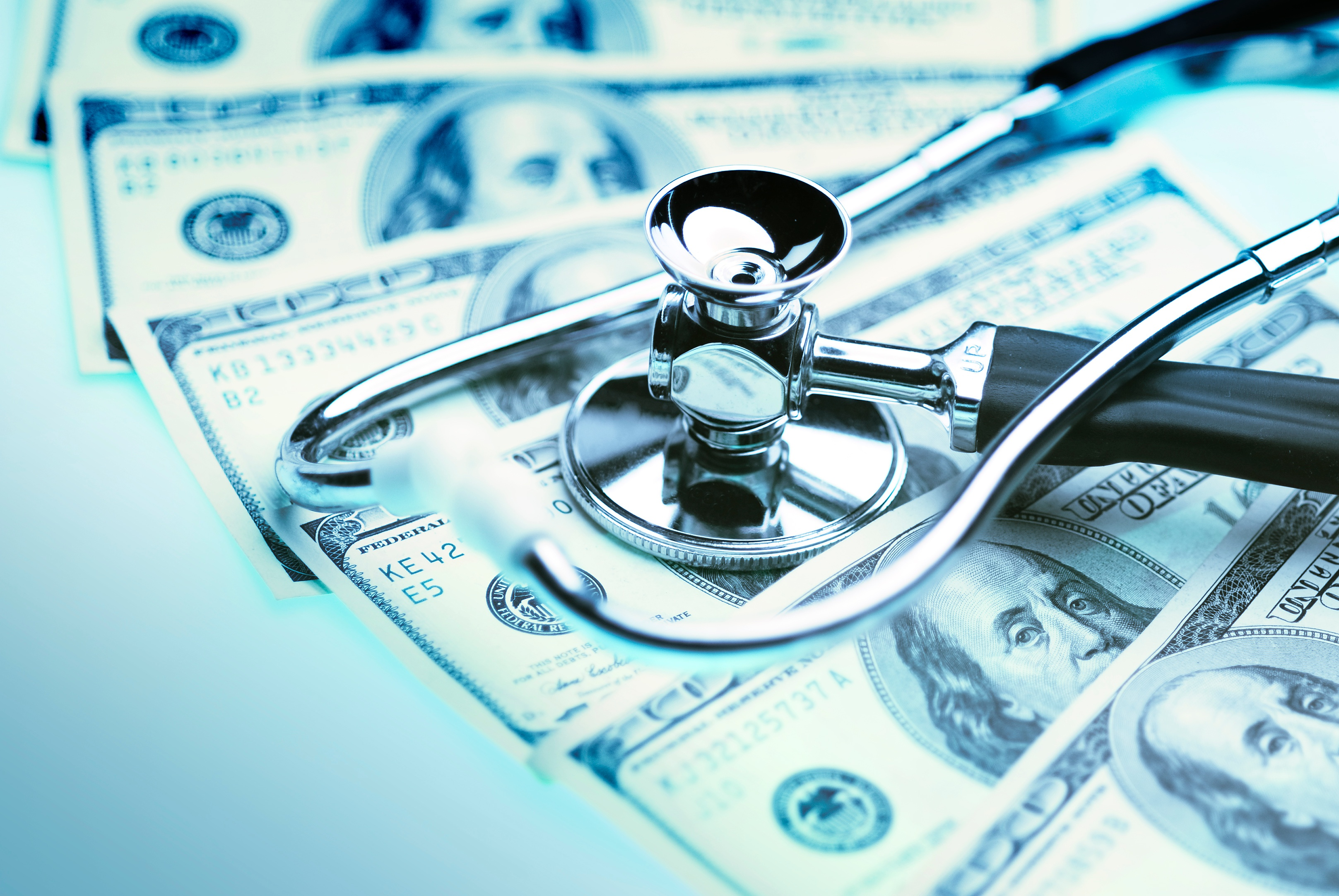 dollars-and-stethoscope-iStock-167248933
