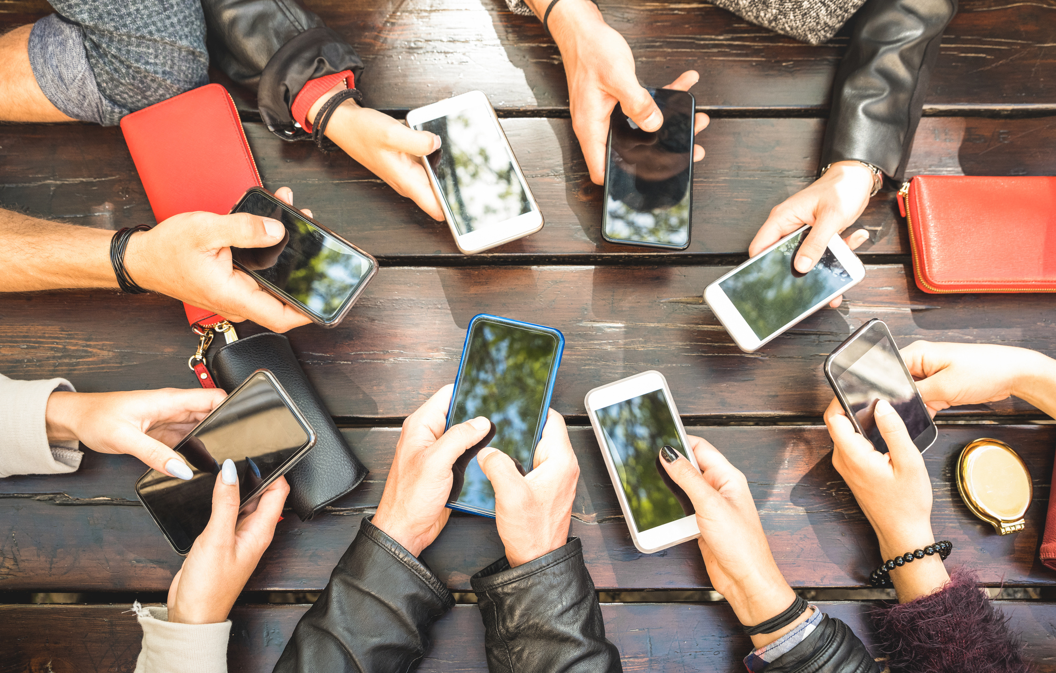 friends-on-mobile-devices-iStock-952414660